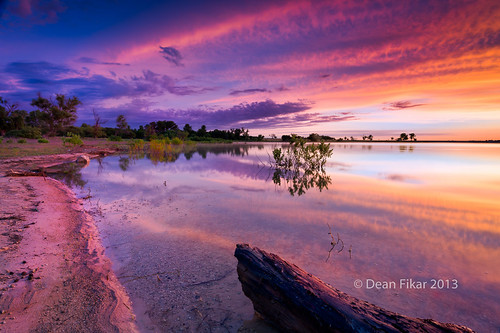 park pink red sky orange lake reflection nature water beauty crimson clouds rural sunrise landscape dawn twilight pond rocks texas unitedstates outdoor horizon scenic logs dramatic vivid nobody calm manmade serene bushes fortworth benbrook bodyofwater