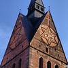 Clock faces on Hanover's Marktkirche: An inverted pentagram and a David's star.
