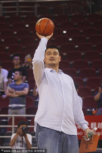 July 1st, 2013 - Yao Ming shoots some baskets before the Yao Foundation charity game in Beijing