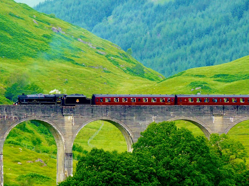 Jacobite Express crossing Glenfinnan Viaduct, Scotland