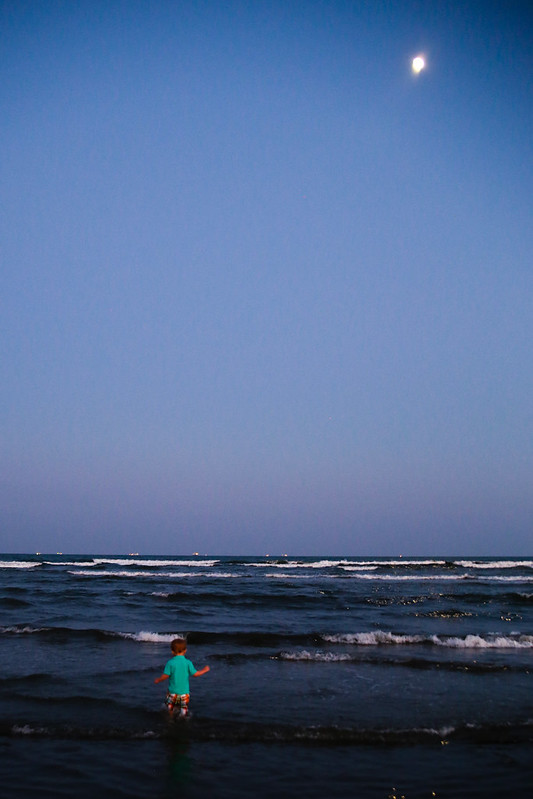 Toddler Wading in the Ocean with the Moon
