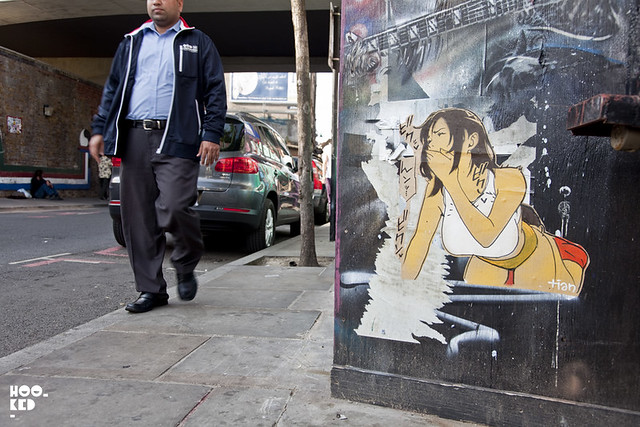 French Street Artist Tian installs work in London.