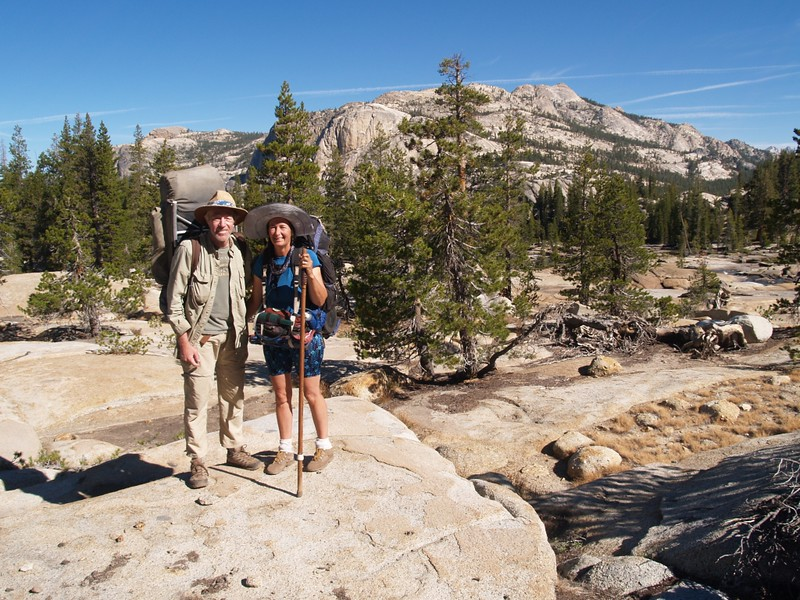 The two of us pose along the PCT overlooking the Tuolumne River, with Wildcat Point, Peak 8886, and Peak 9910