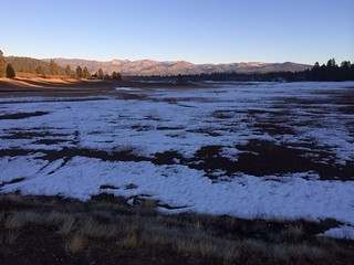 Looking out over Prosser Creek reservoir with the Sierra snowpack in the background