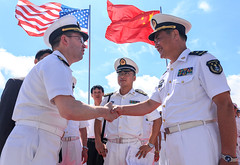 Capt. James T. Jones, commanding officer of USS Shiloh (CG 67), greets Rear Adm. Zhang Wendan, deputy chief of staff South Sea Fleet of the Chinese People's Liberation Army Navy during a ceremony welcoming the ship to Zhanjiang. (U.S. Navy photo by Fire Controlman 2nd Class Kristopher Horton)