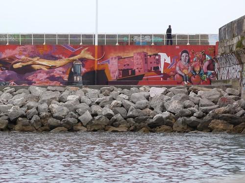 Graffitis del espigón de Gijón