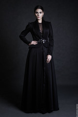 bridal clothing(0.0), overcoat(0.0), little black dress(0.0), tuxedo(0.0), coat(0.0), textile(1.0), gown(1.0), clothing(1.0), collar(1.0), sleeve(1.0), cocktail dress(1.0), outerwear(1.0), fashion(1.0), formal wear(1.0), photo shoot(1.0), dress(1.0),