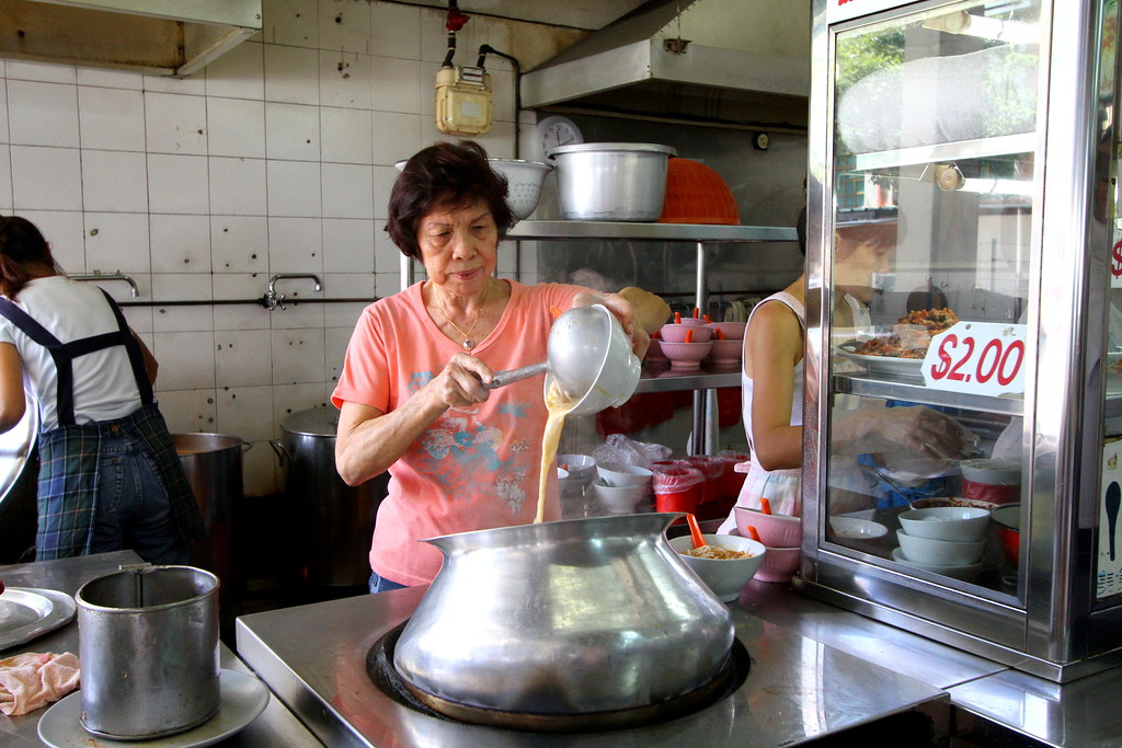 Cooking the Sungei Road Laksa.