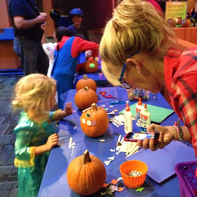 One of my favorite things todo is catch @according2kelly staging her Instagrams. She is so precise when she does it. She was taking pictures of the pumpkin while her daughter was decorating a pumpkin @discoverycube last night #spookyscience #scienceripley