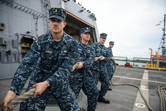 Sailors aboard USS Freedom (LCS 1) participate in a line handling detail as the ship arrives in Brunei, Nov. 18. (U. S. Navy photo by Mass Communication Specialist 3rd Class Karolina A. Oseguera)