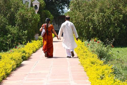 An indian couple enjoying the gardens
