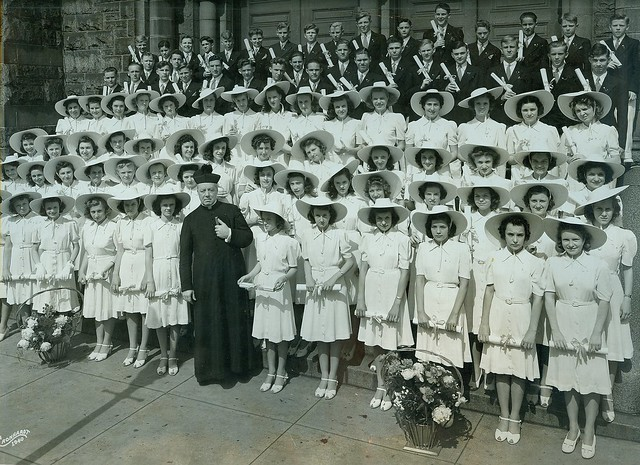 Catholic priest with girls in hats Baltimore M.D.
