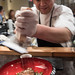 Chef Koji Hagihara shaving the frozen foie gras over the duck charsiu