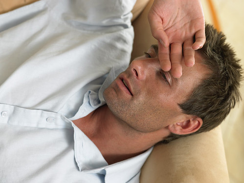 man showing signs of an illness and not feeling well