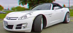 saturn sky(0.0), automobile(1.0), automotive exterior(1.0), wheel(1.0), vehicle(1.0), automotive design(1.0), opel gt(1.0), bumper(1.0), land vehicle(1.0), luxury vehicle(1.0), sports car(1.0),