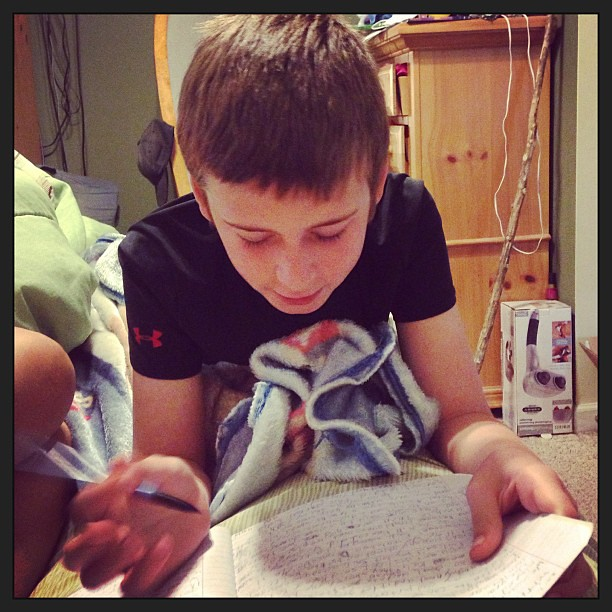 My 9 yr old reading to me from the journal he kept on his CO vacation.
