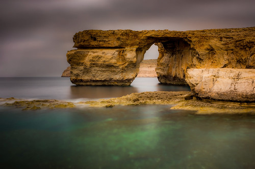 longexposure sea window rocks mediterranean day arch cloudy azure malta cliffs limestone gozo dwerja