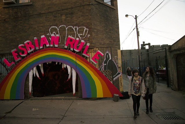 "The outside of the haunted house is a rainbow that says ""Lesbian Rule"""