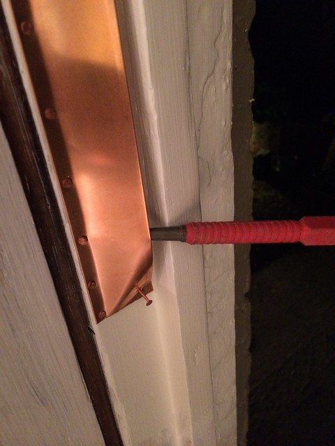 Installing spring bronze weather stripping for antique for Window weather stripping