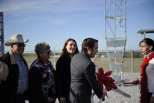 Oklahoma Rural Development State Director Ryan McMullen  joins project representatives, elected officials, and community representatives to cut a ribbon officially declaring the completion of the 1st of 30 towers, comprising the new broadband network.
