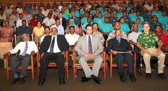 seated dignitaries at conference