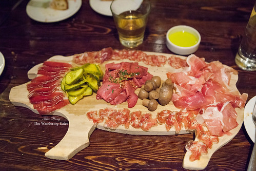 Charcuterie on a wooden pig-shaped tray