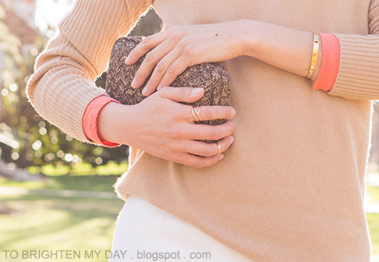 camel sweater, orange tee, tweed clutch