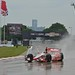 Sebastien Bourdais runs in the rain
