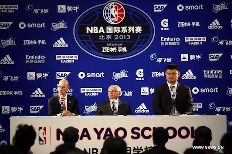 October 15, 2013 - Yao Ming at a press conference in Beijing with NBA commissioner David Stern to announce the NBA Yao School
