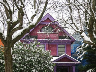 Purple house in snow