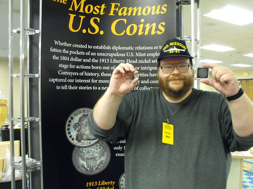 John Burns holding the 1804 dollar and the 1913 nickel
