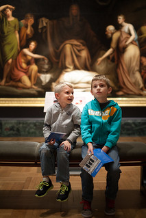 Young lads discuss fine art