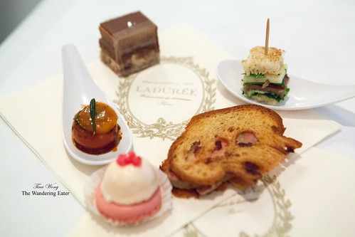 First round of food - Roast cherry tomato, rose religieuse, foie gras toast, and mini sandwich