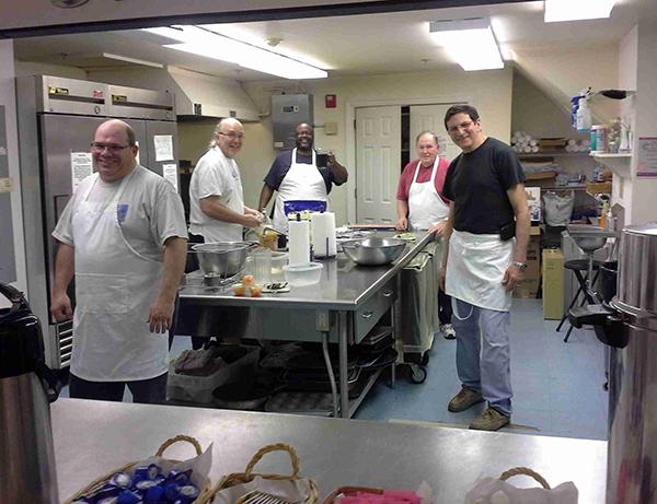 The men cook pancakes