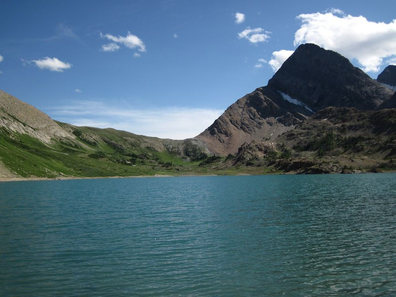 Looking south over the waters of the unnamed lake toward Pulsatilla Pass