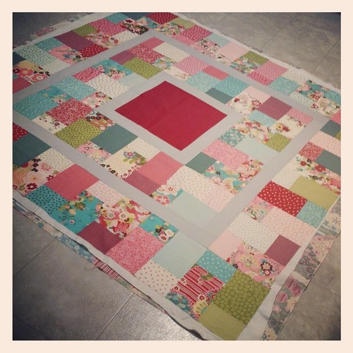 Basted a quilt, pattern by Sew Happy Geek very happy with using the kitchen floor.