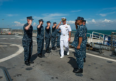 Vice Adm. Scott H. Swift arrives aboard USS Freedom (LCS 1), June 10. (U.S. Navy photo by Mass Communication Specialist 3rd Class Karolina A. Oseguera)