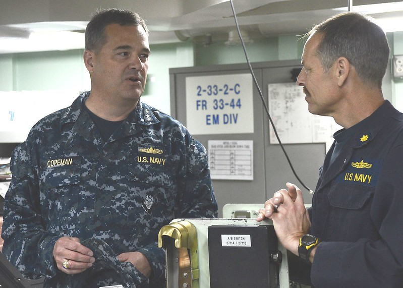 SAN DIEGO - Vice Admiral Tom Copeman, commander of Naval Surface Force, U.S. Pacific Fleet talks with Lt. Cmdr. David Harris, chief engineer aboard amphibious dock landing ship USS Green Bay (LPD 20).