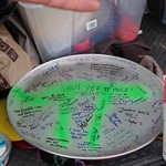 A decommissioned pi plate signed by all for the TD