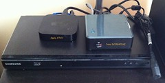 Intel NUC DCCP847DYE - Next to an Apple ATV3 and a Samsung BluRay Player