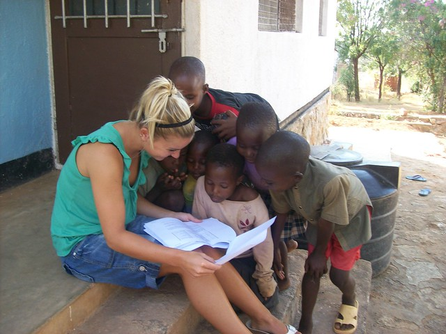 Visitor to Buigiri sharing swahili phrases with kids during village experience tour with watusafaris
