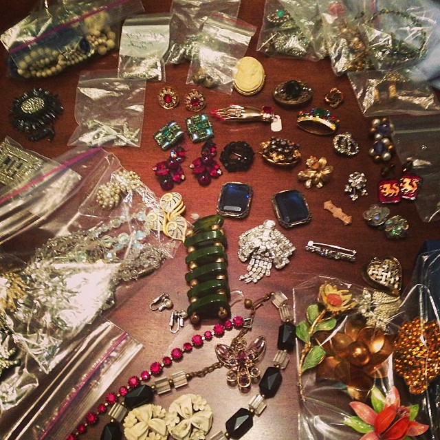 Sorting out the costume jewelry haul.