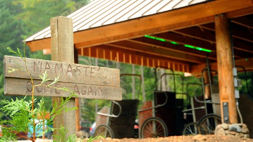 NAMASTE', COME AGAIN, sign, carts in new log and wood shed, Breightenbush Hot Springs, Marion County, Oregon, USA by Wonderlane