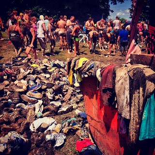 A pile of muddy shoes and clothes.