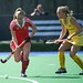Sussie Gilbert runs away with ball from her Hockeyroos marker