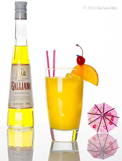 Harvey Wallbanger Cocktail with bottle of Galliano