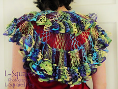 Back view of shawl being modeled - hangs down to mid-back.