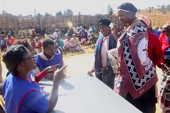 Women in Swaziland's Ekwendzeni Chiefdom register to vote for the primary election. Analysts say that chauvinistic practices are being used to prevent women from participating in the Aug. 24 elections. Credit: Mantoe Phakathi/IPS