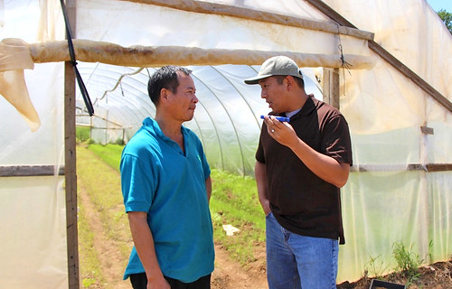 New Jersey farmer Liang Shao Hua listens to NRCS technical advisor Frank Wu provide advice in Chinese Mandarin, Liang's native language. His limited English proficiency restricted his exposure to USDA farm programs until Tropical Storm Sandy made it necessary for Liang to connect with the department for assistance. He is now an FSA loan recipient and appreciates the cost-share benefits of the Emergency Conservation Program funds that assisted his family's clean-up efforts.