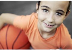 Girl smiling with basketball